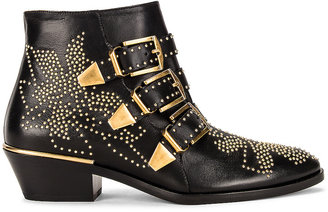 Chloé Susanna Leather Studded Booties in Black & Gold | FWRD