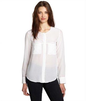 Wyatt white silk long sleeved slash pocket blouse