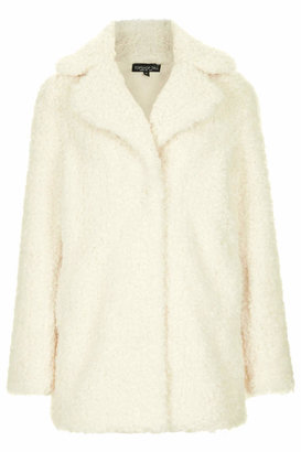 Topshop Tall all over hip length faux fur coat with front popper fastening and side concealed pockets. 80% modacrylic, 20% polyester. machine washable.