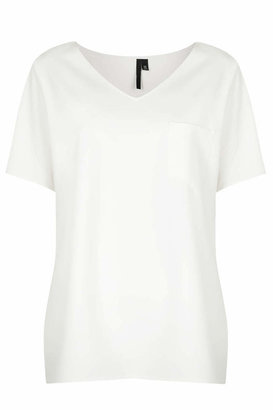 Topshop Clean-cut tailored crepe tee, featuring a pocket to the chest and vented slit sides. style it with ripped jeans